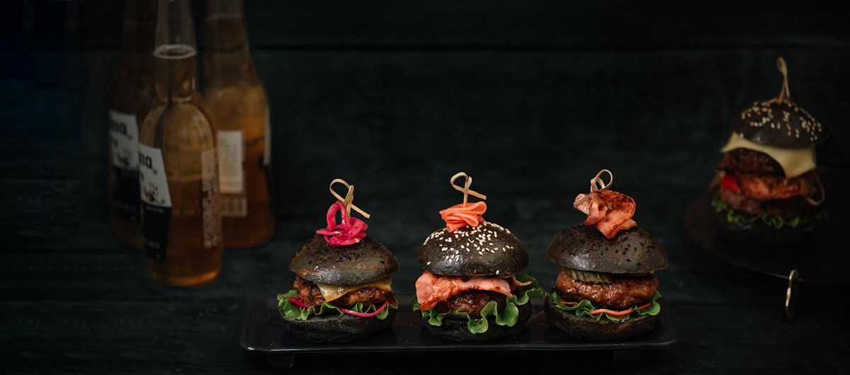 Burger Plate Nelly is a rectangular dessert platter on glass feet in deep night blue with our