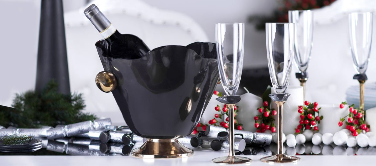 christmas table setting Gala is a gorgeous blue wine ice bucket that sits on a bronze pedestal with handcasted and hand polished bronze handles. Gala is presented together with two handcrafted champagne glasses with the same colour glass jem as Gala.