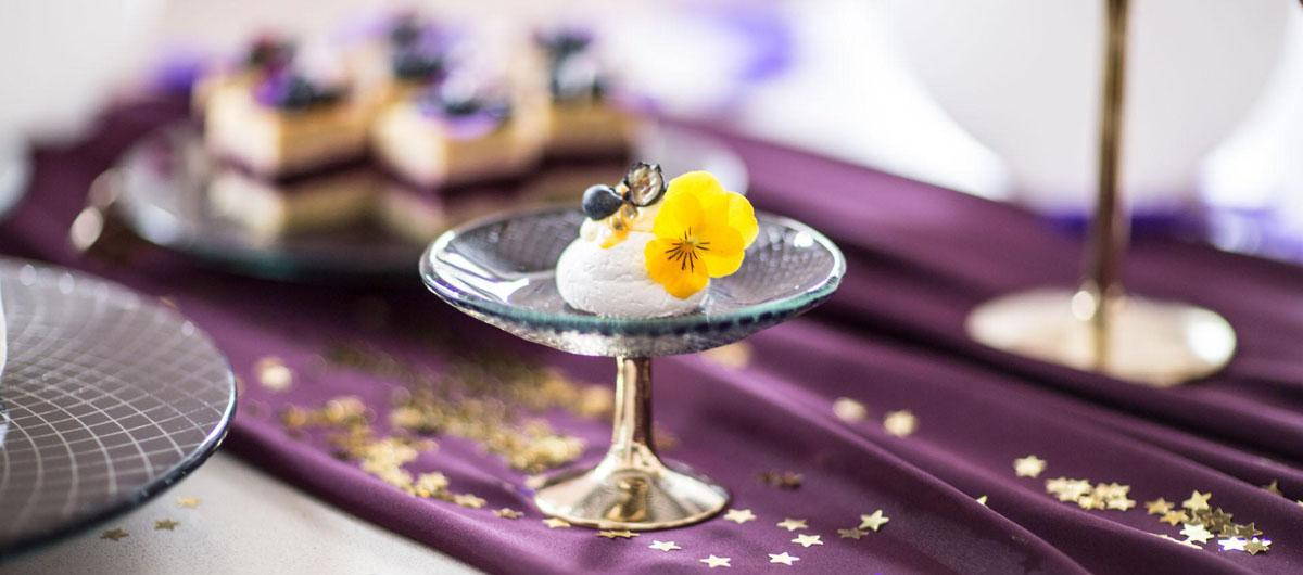 Glass Cake Stand Miranda is a blue cupcake stand and decorated with our royal Venetian Filigree pattern on a hand polished bronze pedestal.