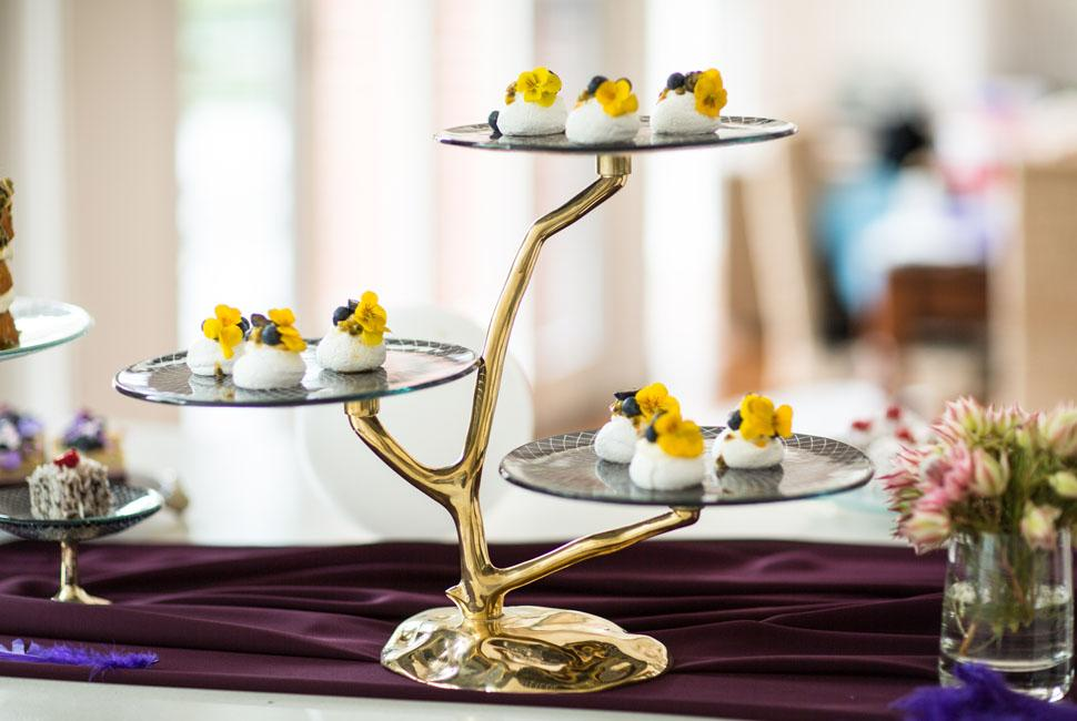 3 tier glass cake stand with sweet on it