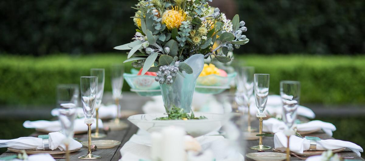 Bridal shower gift - outside table setting with plates, glasses and vase with flowers