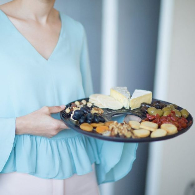 Navy Blue Platter, Selen Round Ottoman Tray With Ribbed Surface with cheeses and dried fruit.