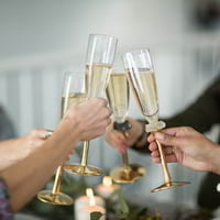 Champagne accessories by Anna Vasily with wedding chamapgne flute glasses and champagne buckets.