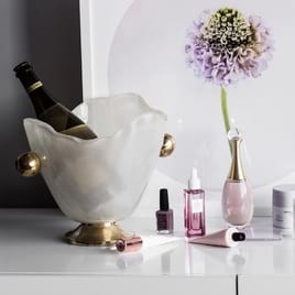 Luxury champagne accessories with ice buckets, champagne flutes and glass coasters by Anna Vasily.