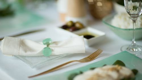 Elegant glass napkin ring holders and the green serviette rings Erika by Anna Vasily.