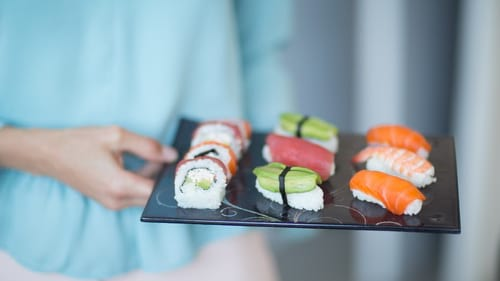 Designer glass sushi plates and bento boes for sushi presentation by Anna Vasily.