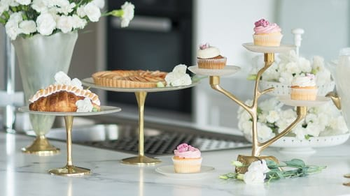 Tall pedestal cake stands and cake plates by Anna Vasily.