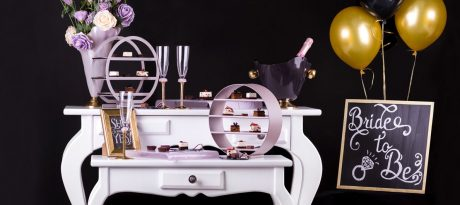 cocktail setting in dark blue and soft shell pink partyware with high tea stands, champage bucket and champagne glasses, sharing tray and pettifour plates