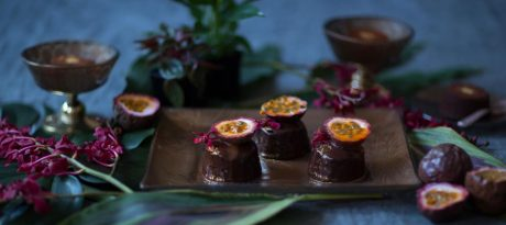 metallic brown dessert plate with floral pattern and raized rim with passion fruit chocolates in jungle decor
